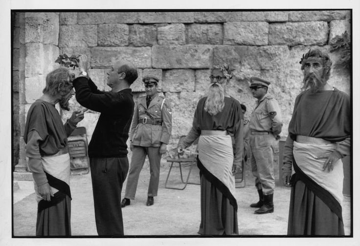 """Epidaurus.1961.Theater festival.Interval during the play""""Medea""""(Maria CALLAS in the main role).Costumes designed by the Greek painter TSAROUCHIS,on the left,arranging the actor΄s costume."""
