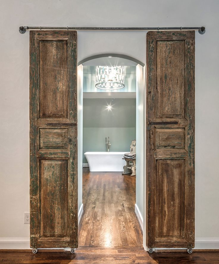 Barn doors to the master bath create a stunning and dramatic look