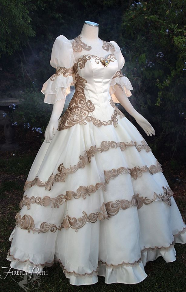 I can see a Disney character coming from the dress https://www.facebook.com/FireflyPath/photos/a.325109530913418.78395.179831978774508/1062729207151443/?type=3