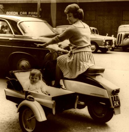 scooter+ sidecar+ baby carriage - one of those things you couldn't get away with today.