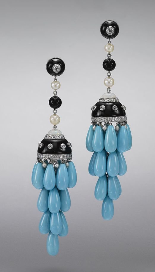 PAIR OF TURQUOISE, ONYX AND DIAMOND PENDANT-EARRINGS. The multi-tiered fringes of turquoise drops capped by segments of onyx decorated with old European-cut diamonds and half beads of opal, suspended from fringes of onyx beads and cultured pearls, the total diamond weight approximately 3.20 carats, mounted in platinum.