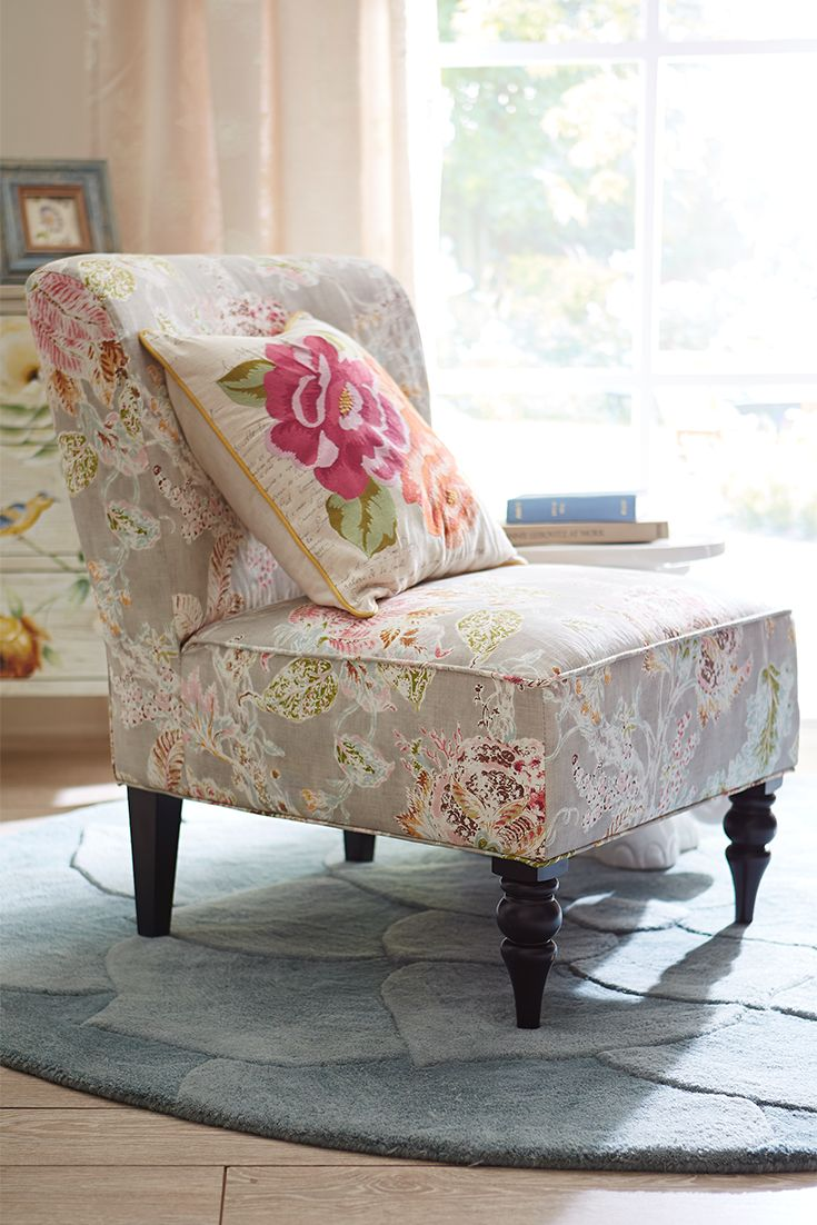 Pier 1's space-saving Addyson Chair in this tailored, Jacobean floral design can make you feel like you're sitting in your own vintage garden.