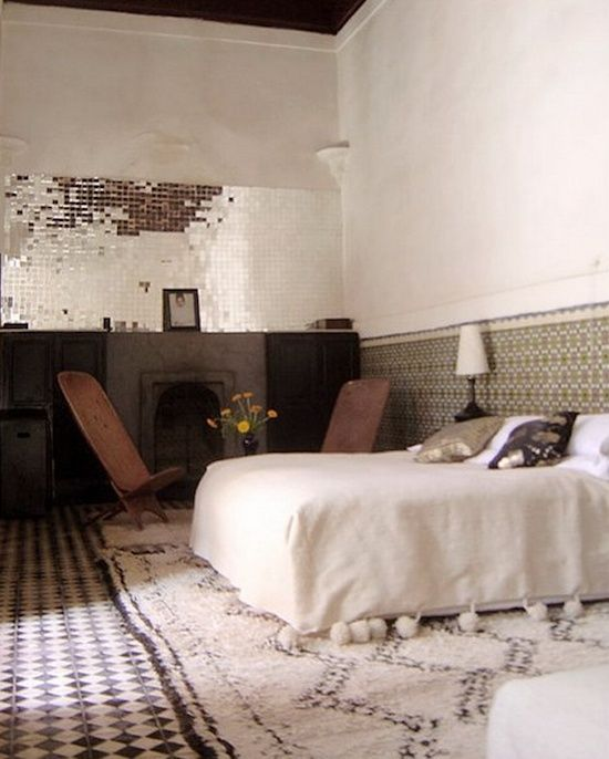 i think those mirror tiles are kind of awesome. and the floor. and the pom poms on the bedspread.