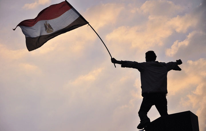 The Egyptian flag waving in the sky