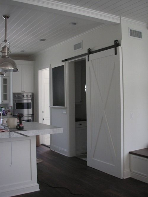 P2 Design Inc. would love a sliding door to separate the pantry/laundry room from kitchen