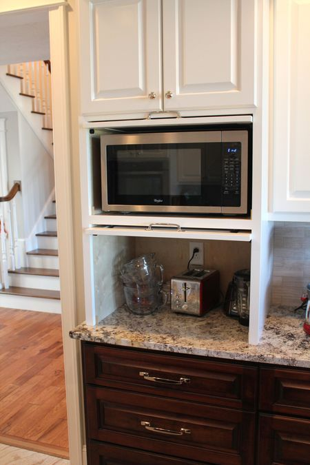 Micro appliance garage hides the microwave and small for Kraftmaid microwave shelf