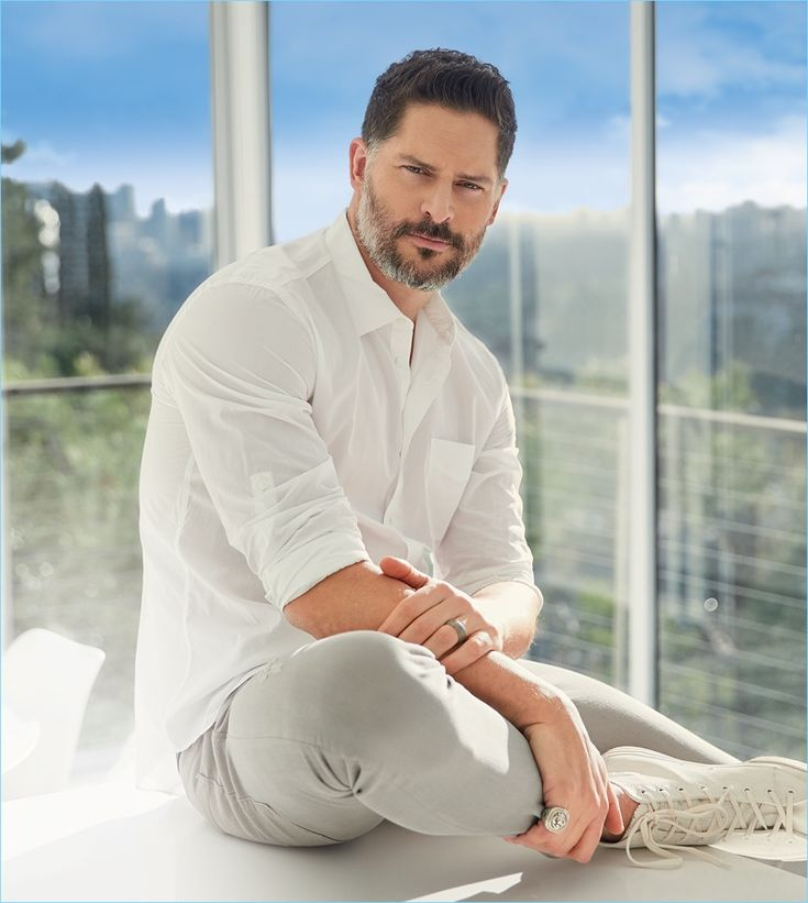 A summer vision, Joe Manganiello wears a John Varvatos white shirt with Bottega Veneta jeans, and Converse high-top sneakers.