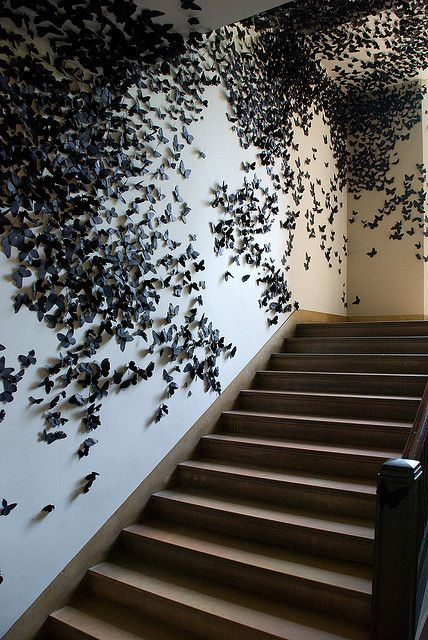An art installation in the Philadelphia Museum of Art made up of thousands of black paper butterflies (or are they moths?), entitled Black Cloud by the artist Carlos Amorales.