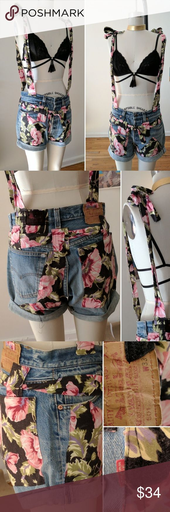 "1990s VINTAGE LEVI'S Cut Off JEAN SHORTS Overalls One of a kind, vintage LEVI Western Wear cut off Jean SHORTS with 90s FLORAL pattern PATCHES and ""suspender"" overalls!! Sooo 90s ALA Blossom & Full House. These are legit VINTAGE! -Super cute perfect with a bra for a FESTIVAL! Labeled 33"" waist but I believe they were men's pants altered to be women's? They fit more like a 29-30"". I'm a 28"" waist and I wore them baggy and low. The form has a 26"" waist. -Very good condition with normal signs…"
