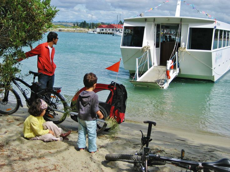 The Gates Accommodation guests with our cycles on The Great Taste Trail at the Mapua Ferry.