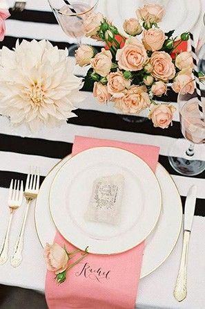 Muted pinks and pale flowers look great with black and white stripes. | See more trending table runners for weddings here: http://www.mywedding.com/articles/9-trending-table-runners-for-weddings/