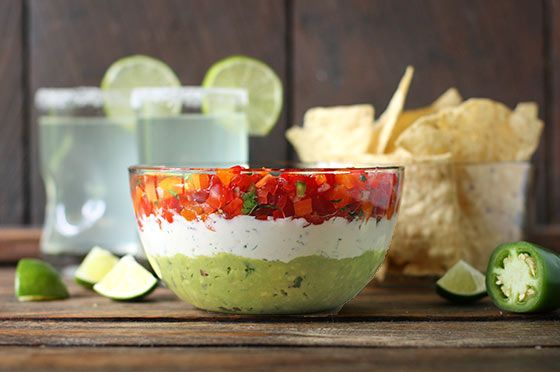 Triple Layer Guacamole Creamy Cotija Confetti Salsa Party Dip - savory and creamy, this salsa party dip is a crowd-pleasing hit.