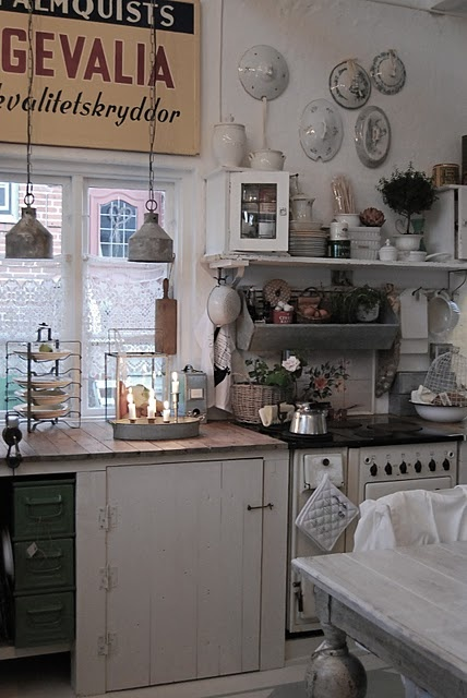 Simple hook and loop latch.  Very cute.  Love the tin pin of supplies, the shelf and the industrial sconces.