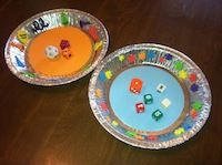 Muted Dice rolling with foam trays....LOVE this idea for centers! great way for them to stay on table and not floor!