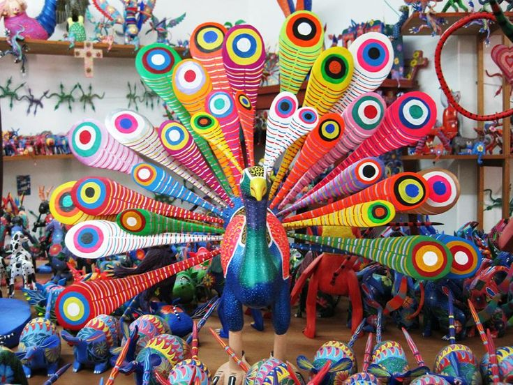"A favorite Mexican folk art, alebrijes are small animal figurines that are hand-carved from the wood of the copal tree and intricately painted by hand, often with paints made from natural dyes such as pomegranate and huitlacoche (corn fungus), an ingredient you may not be familiar with until you go to Mexico. Translating to ""imaginary"" or ""fantasy"", the word alebrije is used to describe the whimsical style of the colorful painted creatures."