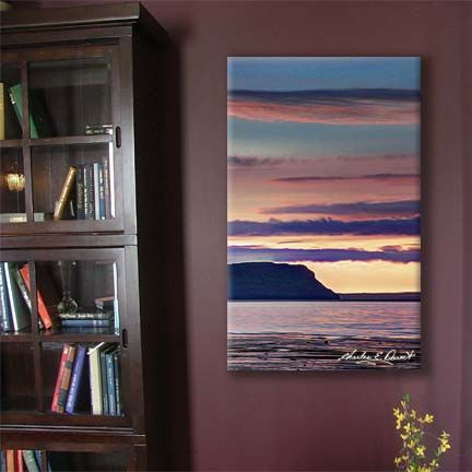 A canvas print hangs in a den...  The image features Mount Blomidon in the Bay of Fundy, Nova Scotia, Canada. Available at: www.charlesedoucetcreatives.com