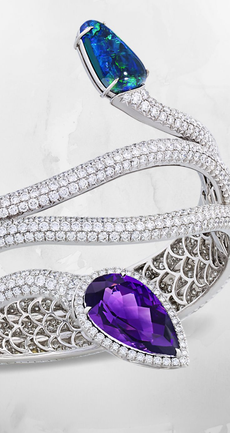 this eye catching bracelet makes a statement the hand crafted 18k white gold bracelet is embedded by 18 90 total carats of brilliant white diamonds