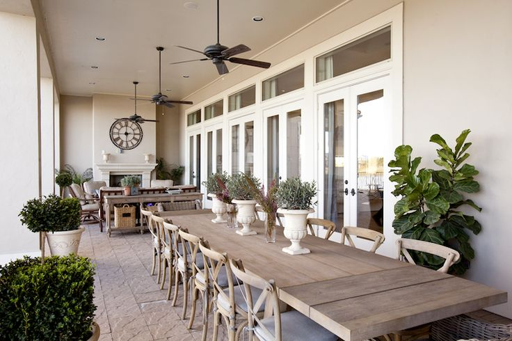 French doors transom windows wood planks outdoor dining table French cafe chairs outdoor fans  Beautiful deck/patio