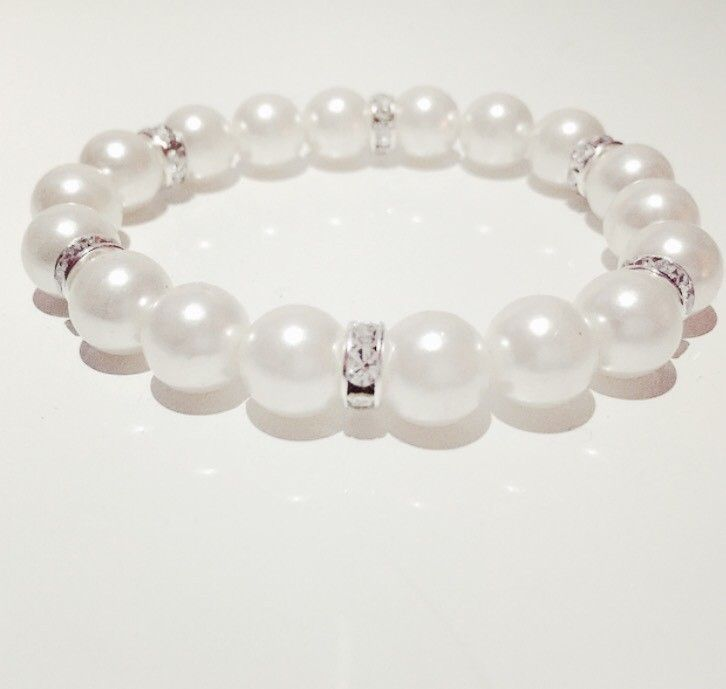 Armband White pearl via mBracedesigns. Click on the image to see more!