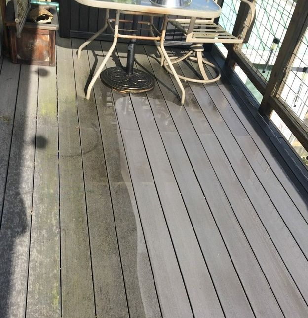 Power washing a deck to make it look new again
