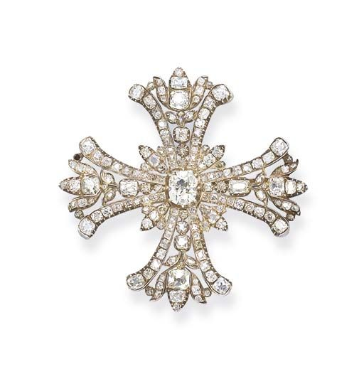 AN ANTIQUE DIAMOND CROSS BROOCH   Designed as a Maltese cross, the openwork arms and centre set with cushion-shaped and rose-cut diamonds, mounted in silver and gold, circa 1840, 5.5 cm long