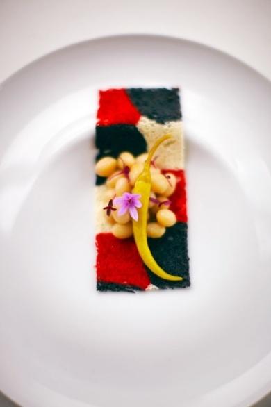A white bean salad atop a sheet of sponge cake from Akelarre, one of three Michelin three-star restaurants in San Sebastián.