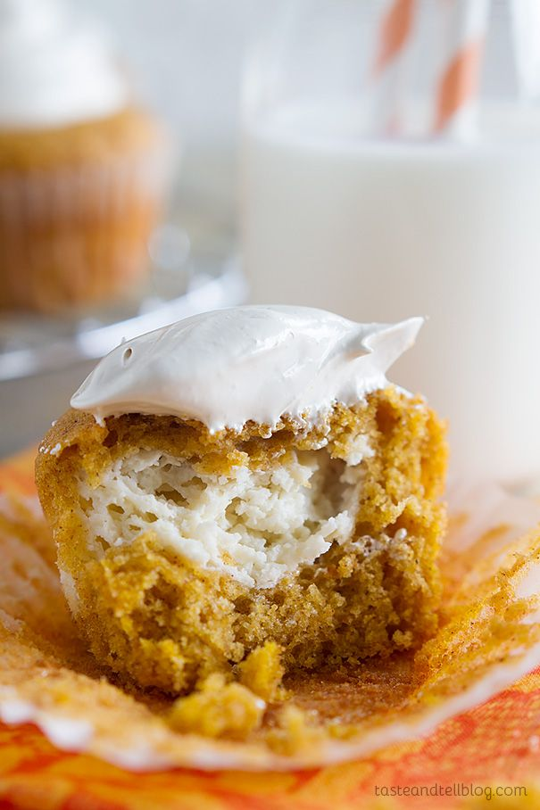 Pumpkin Cheesecake Cupcakes Recipe - these pumpkin cheesecake cupcakes have moist pumpkin cupcakes that have a cheesecake center baked in, and then are topped with a light brown sugar marshmallow frosting.