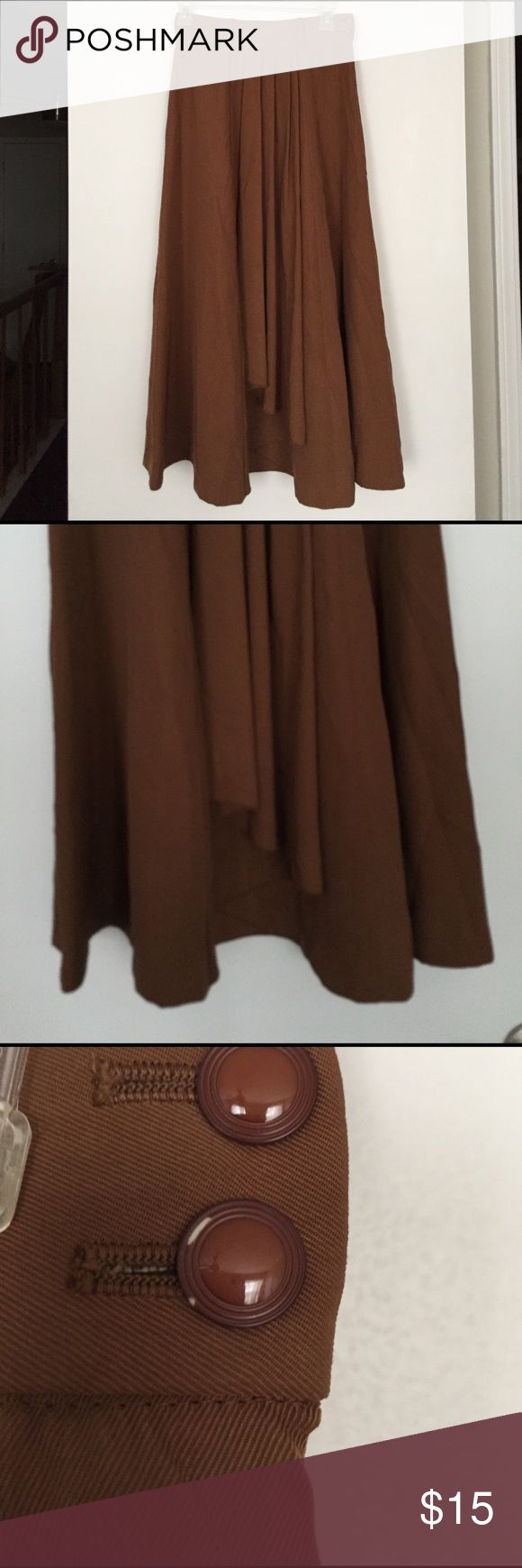 Vintage brown maxi skirt This is a nice heavy lined skirt with side zipper and vintage button closure. It has belt loops and nice drape detail. I never wore it cause I didn't have anything to go with it! No brand, got it at a vintage shop. Skirts
