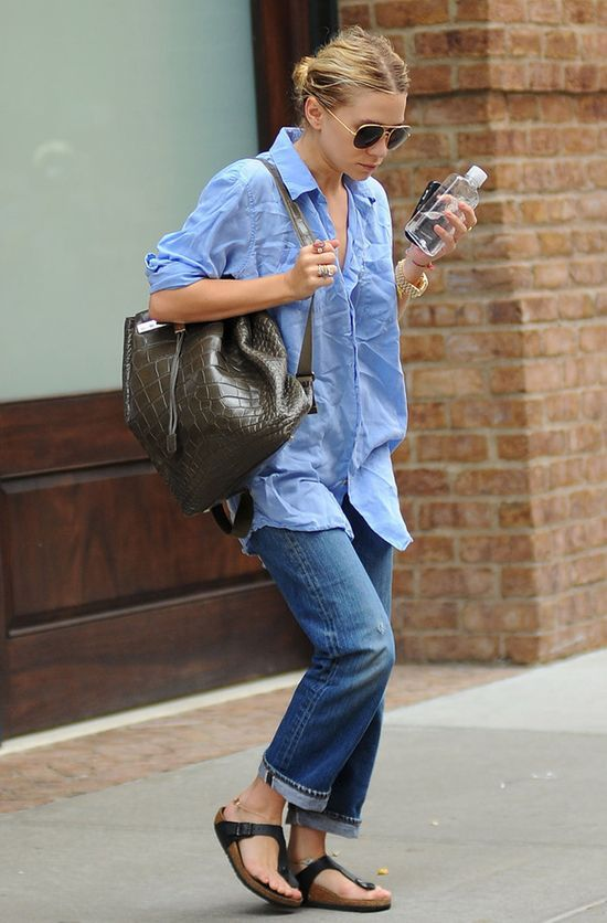 Ashley Olsen in a chambray shirt, denim,  birkenstocks and The Row backpack.