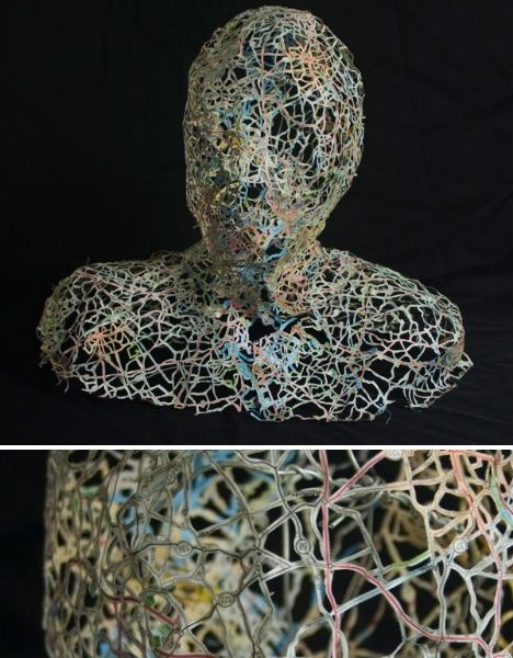 Delicately interwoven like veins, the tiny green, blue and red strips of maps used to create these incredible sculptures are molded around a packing tape form to create a three-dimensional shape. Artist Nikki Rosato removes the land masses, leaving nothing but the roads and rivers behind, reinforcing the paper with wire as necessary...