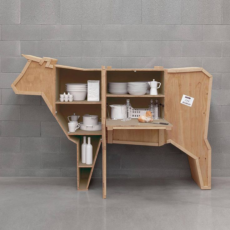 Wow! It's a cow! But not only that, this cow cabinet is also the coolest sideboard ever. Designed to look as if it has just arrived in the post, this quirky item is in fact storage, complete with cupboards and shelves. The wooden sides open to reveal irregular shaped compartments.