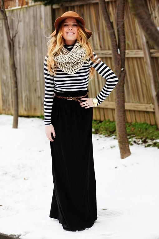 Wearing a skirt in the winter - she's doing it right! Floppy hat, striped shirt, maxi skirt, and infinity scarf to top off.