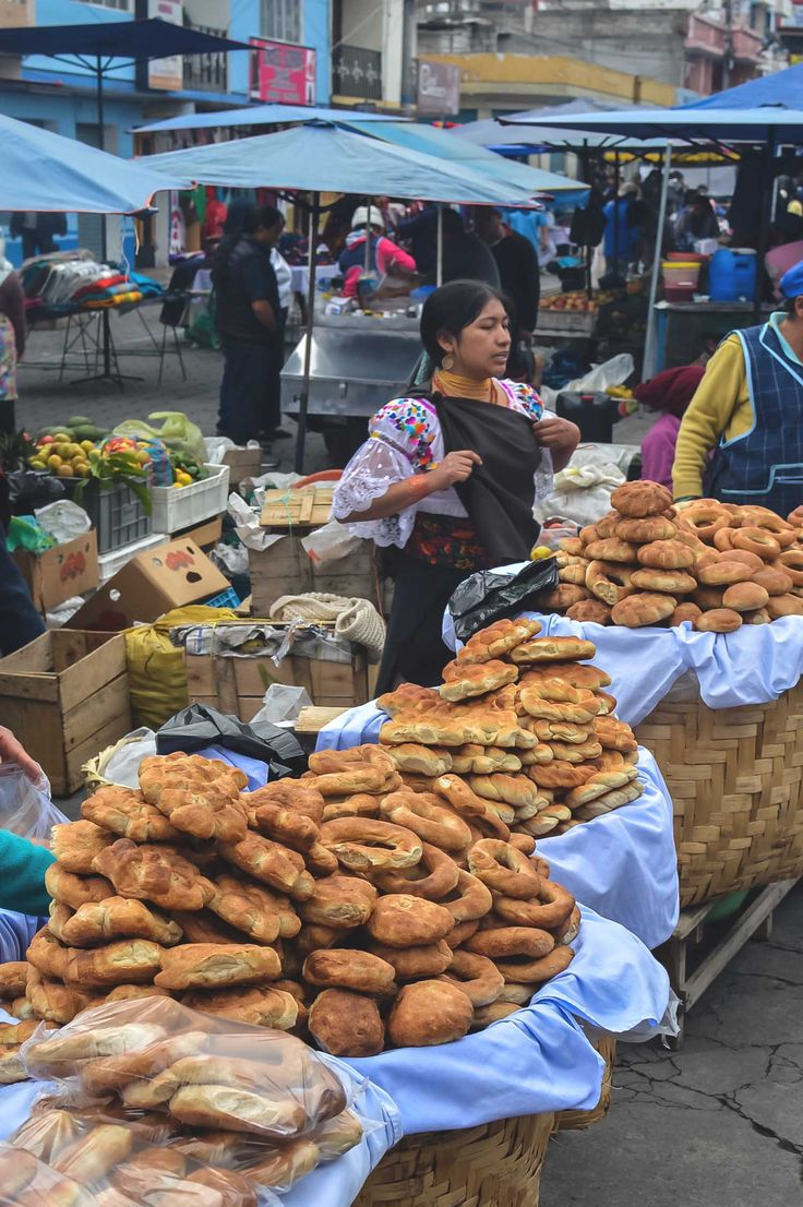 One of the many bread vendors at Otavalo Market, Ecuador | heneedsfood.com