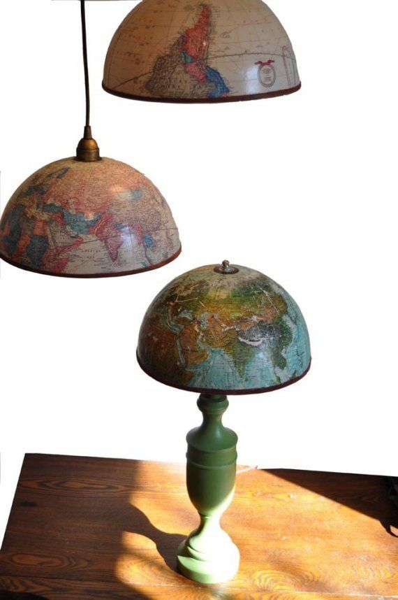 Globe hemisphere lamps. Vintage globes with antique gold and bronze faux-finished intertior. Leather trim and acrylic finish on exterior. Currently available: Blue and green colored globes, hanging pendant or harp style- please specify. Coming soon: brightly colored globe with lime green pendant cord and interior.