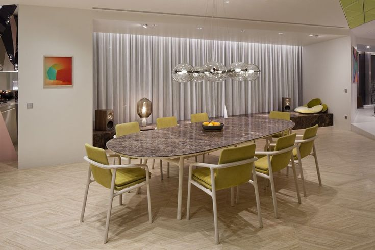 Apartment: Stylish Ritz Apartment in Almaty, Kazakhstan by COORDINATION, Night View of Ritz Apartment Kitchen and Dining Room by COORDINATION with 9-Piece Dining Set and Bulb Pendant Lamp and White Window Curtains and Ceramic Floor Tile