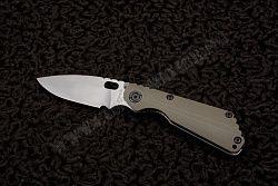 "Этот нож SNG CC от компании Strider Knives имеет острое, как бритва лезвие из нержавеющей стали CPM-S30V, обработанное методом варки с камнями. Лицевая сторона рукояти выполнена из G10, обратная предсталяет собой исключительно надежный титановый механизм ""фрейм лок"". This SNG CC by Strider Knives features a CPM-S30V stainless steel razor sharp blade with a stone wash finish. The front side of the handle is green G10 and the opposite side is stone washed titanium. Secure frame lock mechanism."