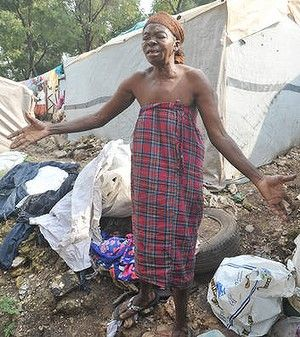 An elderly woman weeps outside her dwelling in a tent city in Port-au-Prince following the destruction caused by Hurricane Sandy.  Many Port-au-Prince residents are still living in vast tented areas after the catastrophic 2010 earthquake.