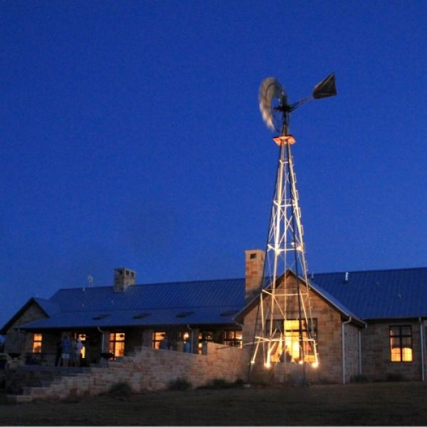 North Texas Ranch Home with Antique Windmill. Design by Steve Chambers, registered Architect in Texas and Oklahoma.
