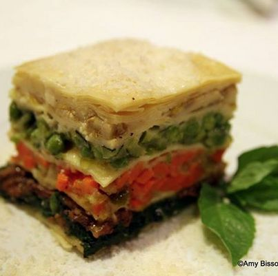 A summer favorite: the Lasagna di Verdure.  With five layers of oven-baked homemade egg dough lasagna lightly veiled and layered with individually prepared vegetables, its a slice of heaven