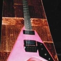 From my hair band days. Solid guitar, sounded like an SG, but uncomfortable.