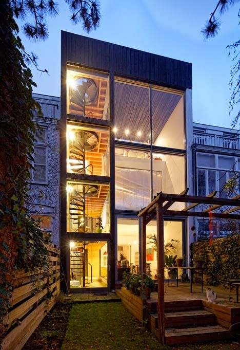 Dutch studio Personal Architecture overhauled a traditional townhouse in The Hague by adding mezzanine floors, a glass elevation, a triple-height kitchen and a spiral staircase.