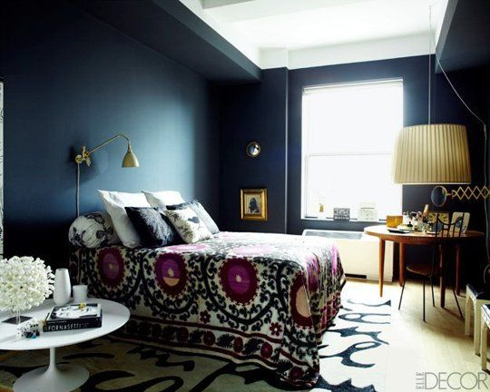 Moody cool dark bedroom wall color, deep navy livened up with white and punchy fuschia and gold. Like!