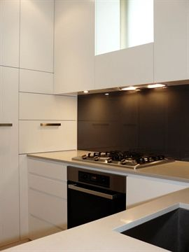 Urban countertop with ?black splashback