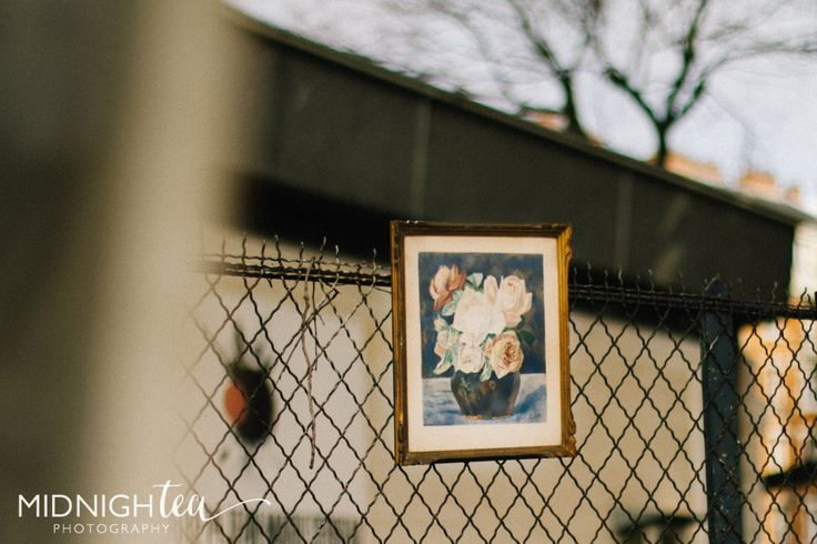 Lonely painting on a chain linked fence! Love this shot from Vanves Flea Market in Paris, France