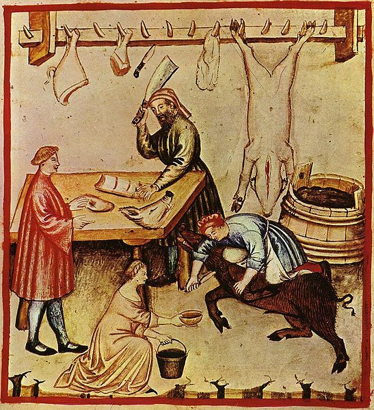 A 14th-century butcher shop. A large pig is being bled in preparation for slaughter. A whole pig carcass and cuts are hanging from a rack and various cuts are being prepared for a customer.