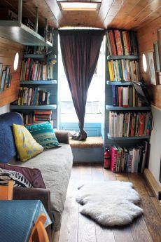 Saloon. wooden narrow boat living room full of book shelves
