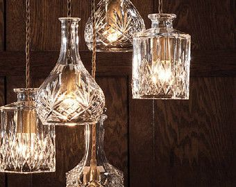 This is a great idea!  You can buy them handmade from TudoandCo at etsy.com  https://www.etsy.com/listing/168954639/wine-decanter-bottle-pendant-light?ref=favs_view_4&atr_uid=16773531