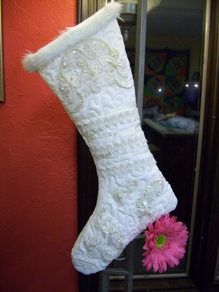 Holiday stocking made out of a wedding dress - I want to do this for my kiddos next year with my wedding dress. (picture on link gone - but this is lovely and the mice just ate the felt ones I made for the kids when they were born)