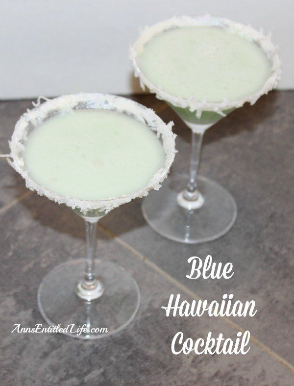 Blue Hawaiian Cocktail Recipe;  This classic Blue Hawaiian Cocktail will have you thinking of sandy tropical beaches and warm summer breezes. A delightful blend of rum, coconut, pineapple and blue Curaçao, this Blue Hawaiian Cocktail Recipe is perfect for any occasion. Aloha!