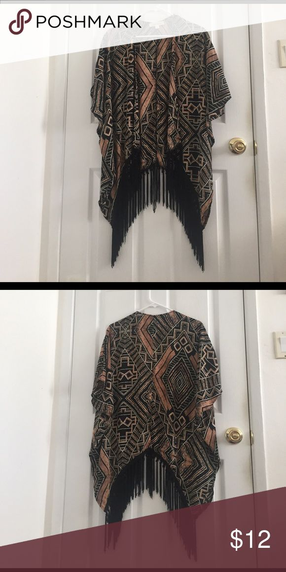 Tribal Cardigan Cute Tribal cardigan with short sleeves and fringe detailing along the hem. Soft and comfortable. Excellent condition! Jackets & Coats